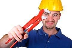 Mens met rood hulpmiddel stock afbeelding