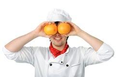 Mens met sinaasappelen stock afbeelding