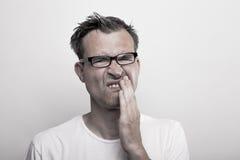 Mens met tandpijn Stock Afbeelding