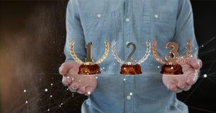 Mens met trofeeën op handen Stock Foto's
