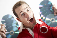 Mens met verrast gezicht een CD Stock Foto's