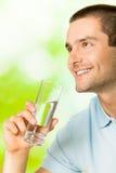 Mens met water Royalty-vrije Stock Afbeeldingen