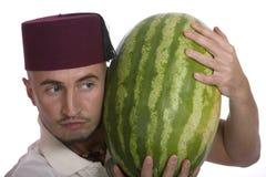 Mens met watermeloen Stock Afbeelding