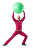 Mens met Zwitserse bal die oefeningen doen Stock Afbeeldingen