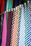 Mens Neck Ties. Hanging colorful Mens Neck Ties at the flea market Stock Photos