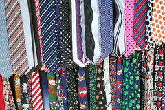 Mens Neck Ties. Hanging colorful Mens Neck Ties at the flea market Royalty Free Stock Photo