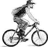 Mens op een cyclus Stock Fotografie