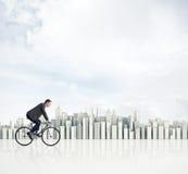 Mens op een fiets Stock Foto