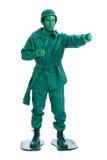 Mens op een groen stuk speelgoed militairkostuum Stock Afbeelding