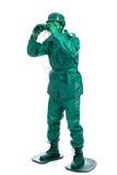 Mens op een groen stuk speelgoed militairkostuum Stock Afbeeldingen
