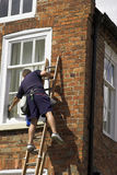 Mens op een Ladder Royalty-vrije Stock Foto's