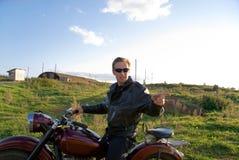 Mens op motorfiets Stock Foto