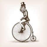 Mens op retro uitstekende oude vector van de fietsschets Stock Foto