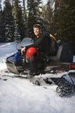Mens op sneeuwscooter. Royalty-vrije Stock Afbeelding