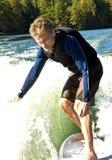 Mens op Surfplank Royalty-vrije Stock Afbeeldingen