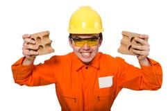 Mens in oranje die overtrekken op wit wordt geïsoleerd Stock Foto