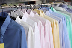 Mens plaid shirts on hangers in a retail store Royalty Free Stock Photos