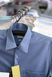 Mens plaid shirts on hangers in a retail store Royalty Free Stock Images