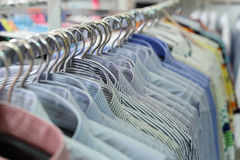 Mens plaid shirts on hangers in a retail store Stock Photo