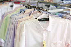 Mens plaid shirts on hangers in a retail store Royalty Free Stock Photography