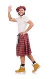 Mens in Schotse die rok op wit wordt geïsoleerd Stock Foto