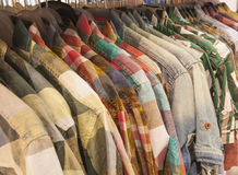 Mens shirts hanging on a rail Stock Photos