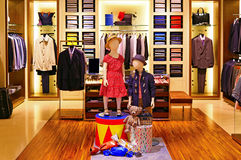 Mens shirts and suiting store. Boutique displaying elegant shirts and suiting for men stock photos