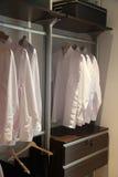 Mens shirts wardrobe Stock Images