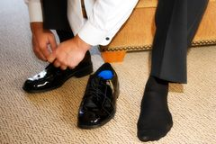 Mens shoes. A groom putting on his shoes Royalty Free Stock Photo