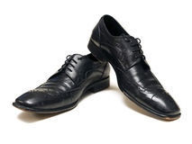 Mens shoes. A pair of black mens dress shoes  over white - plenty of copy space Royalty Free Stock Image