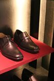 Mens shoes. Mens formal leather shoes arranged in sales display Stock Photography