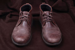 Mens shoes  on brown background Royalty Free Stock Photos