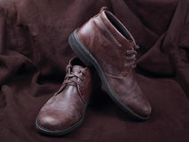 Mens shoes  on brown background Royalty Free Stock Photo