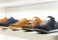 Mens shoes. Collection of men`s shoes in the store royalty free stock images