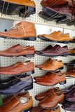 Mens Shoes on Display. Black, tan and brown mens leather shoes on display in shop Royalty Free Stock Photography