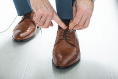 Mens shoes. Male businessman tying shoelaces dress shoes Stock Photography