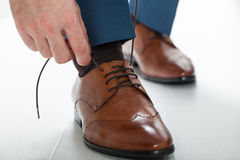 Mens shoes. Male businessman tying shoelaces dress shoes Royalty Free Stock Photos