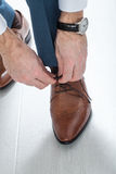 Mens shoes. Male businessman tying shoelaces dress shoes Royalty Free Stock Image