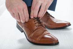 Mens shoes. Male businessman tying shoelaces dress shoes Stock Photo