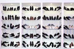 Mens shoes on shelfs Royalty Free Stock Photo