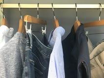 Mens stylish clothing on hangers Royalty Free Stock Photography