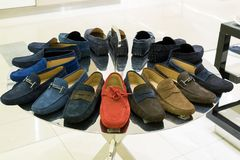 Mens suede summer shoes in store Stock Photo