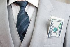 Mens suit with money. Man with a suit and money in pocket Stock Images