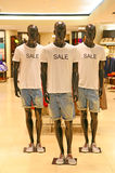 Mens summer clothing. Dummies fitted with men's summer clothing t-shirts and denim shorts, displayed at a clothing store stock photography