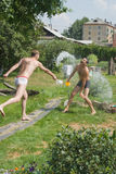 Mens summer games. Men compete in douche by water Stock Photo