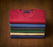 Mens sweater on wooden background Royalty Free Stock Photos