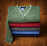 Mens sweater on wooden background Royalty Free Stock Image