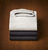 Mens sweater on wooden background Royalty Free Stock Images