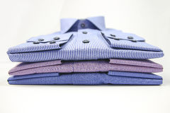 Mens t-shirt folded on background Stock Photo