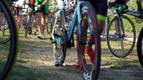 Mens taking bikes to start triathlon distance ironman racing competition